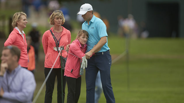 Jordan Spieth hugs his sister Ellie Spieth on No 17 fairway during Thursday play at Colonial CC.