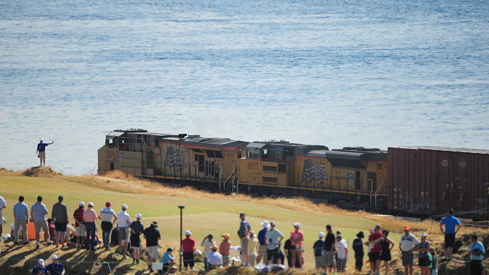A train rumbles by the course during the 2015 U.S. Open.