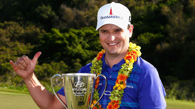 Zach Johnson poses with the trophy after winning the Hyundai Tournament of Champions at the Plantation Course at Kapalua Golf Club on January 6, 2014