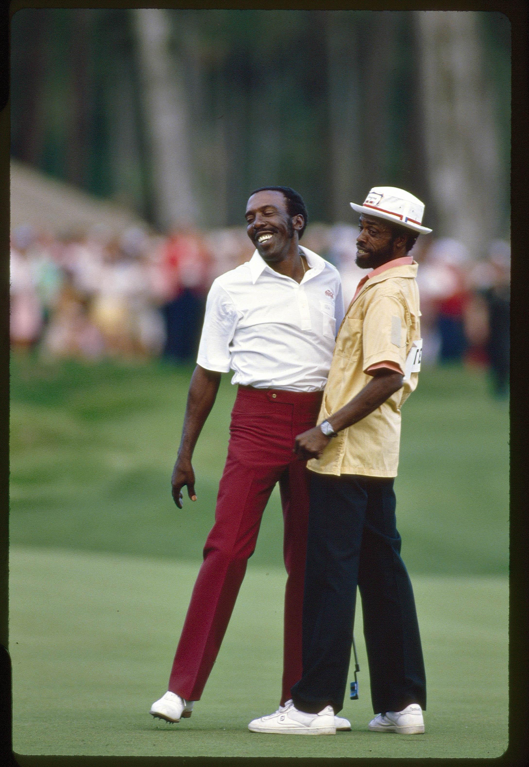"1985 Players Championship: Winner Calvin Peete with caddie ""Golf Ball"" Dolphus Hull."
