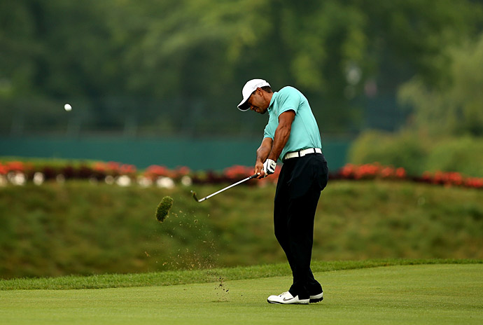 Tiger Woods shot a four-under 66, one of his best rounds of the year, in the first round of the Greenbrier Classic.