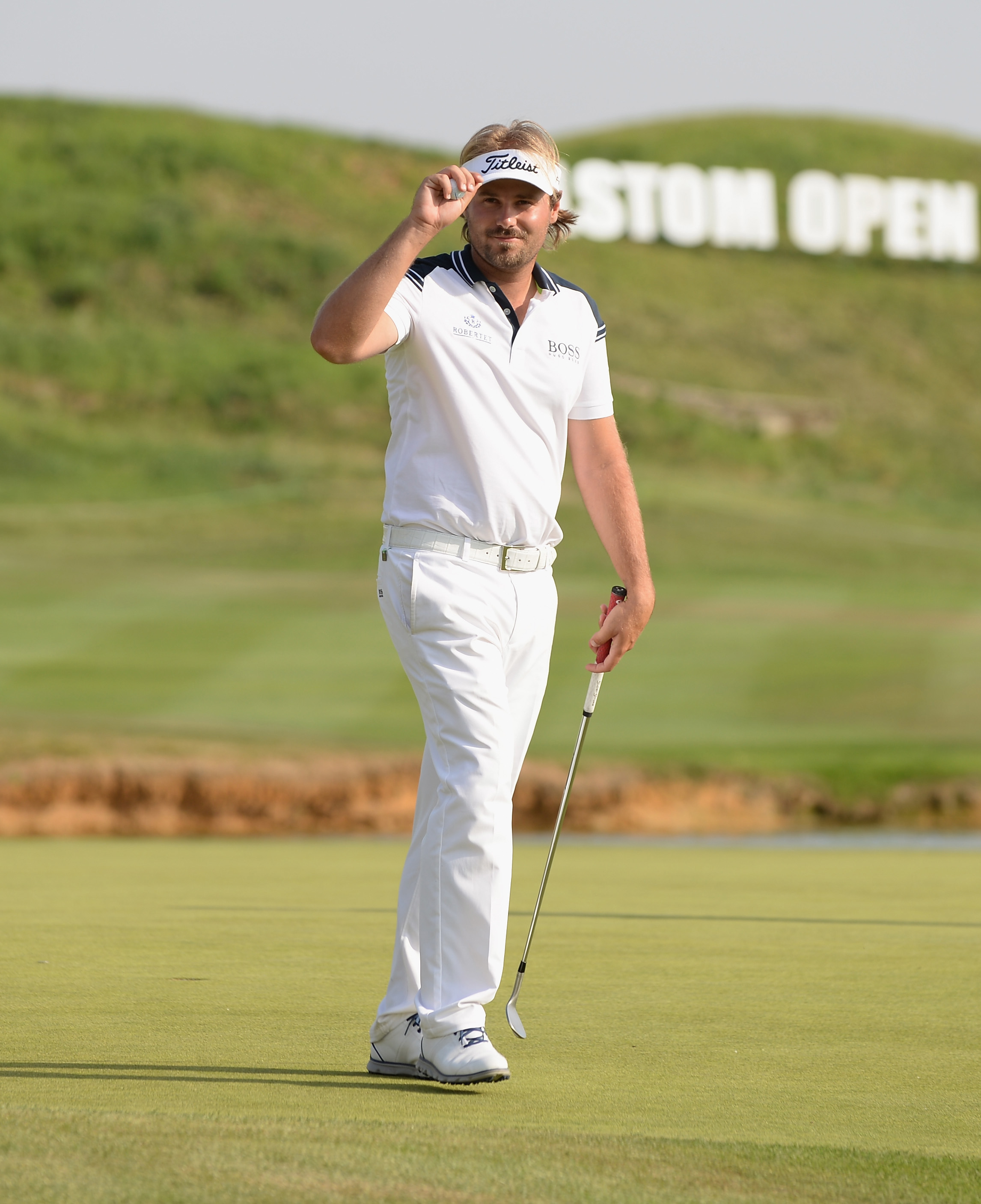 Victor Dubuisson of France acknowledges the applause from the gallery as he finishes at 4 under par during the Alstom Open de France - Day Two at Le Golf National on July 3, 2015 in Paris, France.