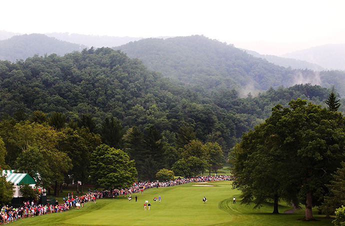 The group of Tiger Woods, David Lingmerth and Steve Stricker walk up the first fairway during the second round of the Greenbrier Classic at the Old White TPC.