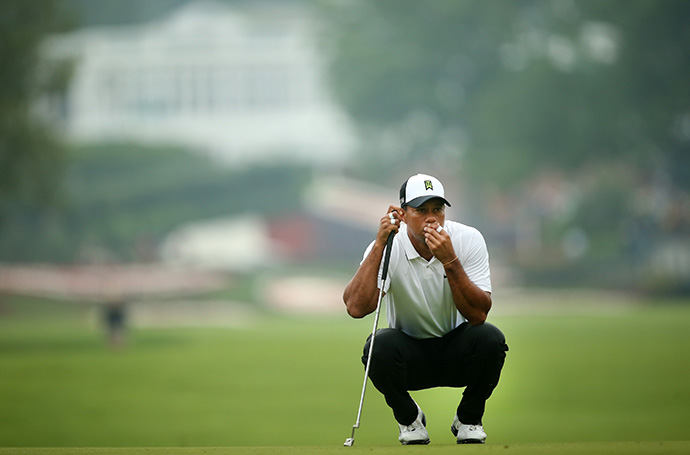 Tiger Woods prepares to putt on the first hole during the second round of the Greenbrier Classic.