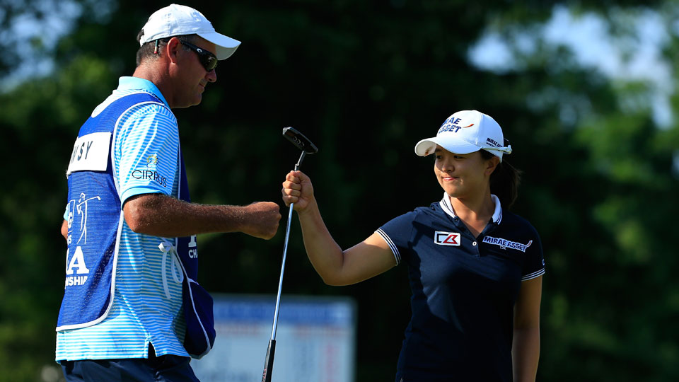 Sei Young Kim of South Korea and her caddie Paul Fusco celebrate her par save on the 16th green during the fourth and final round of the KPMG Women's PGA Championship held at Westchester Country Club on June 14, 2015 in Harrison, New York.