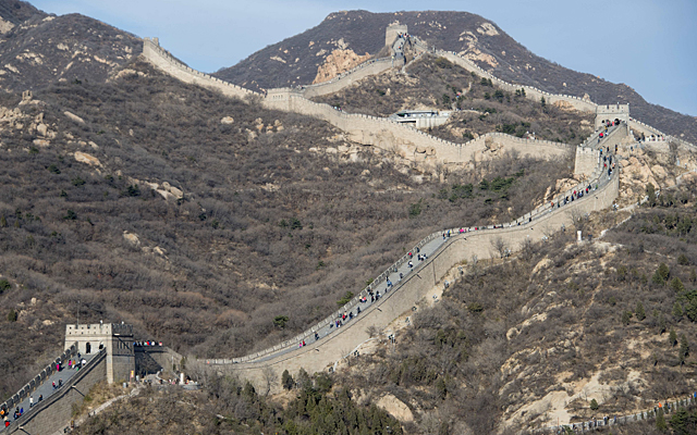 People walk along a section of the Great Wall of China at Badaling, north of Beijing.