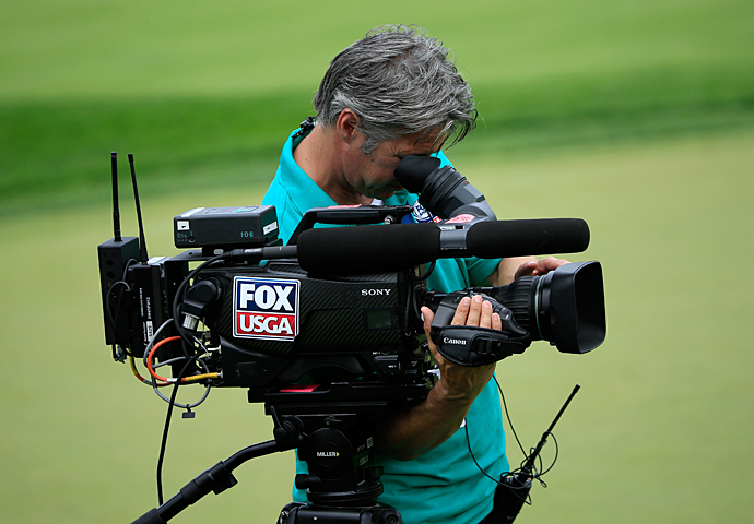 A Fox cameraman follows play during round 1.