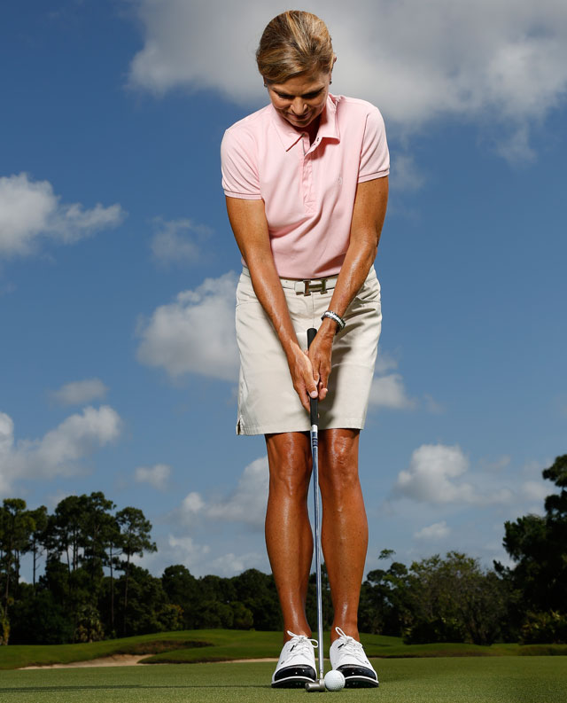Roll putts with your feet close together to develop perfect shoulder alignment.