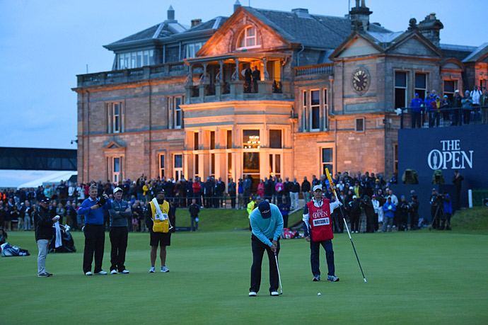 Watson putts out on the 18th hole as darkness descends on the Old Course.