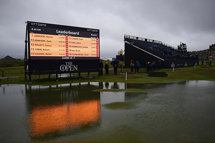 Heavy rains delayed play for more than three hours at St. Andrews on Friday, and left large portions of the 1st and 18th holes submerged in water.