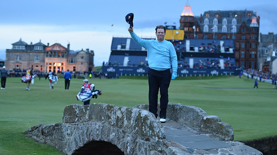 Tom Watson bids farewell to the Open Championship on Swilcan Bridge at St. Andrews.