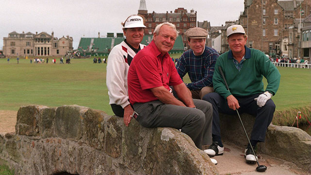 Raymond Floyd, Arnold Palmer, Tom Watson and Jack Nicklaus sit on the Swilken Bridge on the 18th hole at the 1995 British Open at St. Andrews golf course in St. Andrews, Scotland