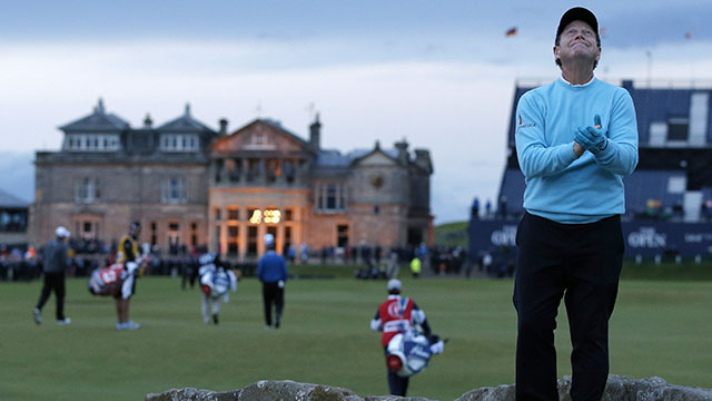 Tom Watson poses on the Swilcan Bridge as he marks his final round in any British Open on day two of the 2015 British Open Golf Championship on The Old Course at St Andrews in Scotland, on July 17, 2015.