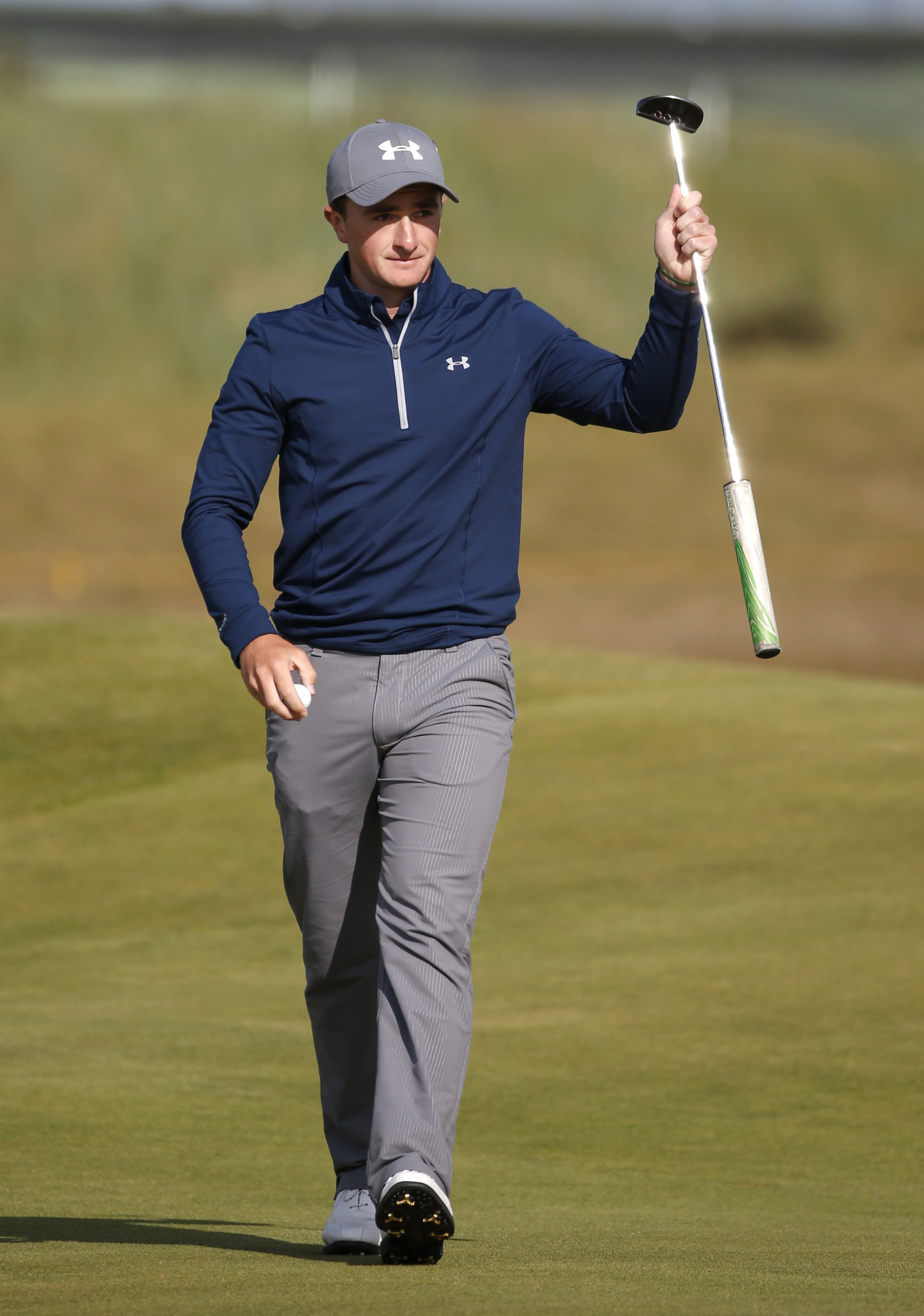Ireland's Paul Dunne gestures after a birdie on the 15th during the third round at the British Open Golf Championship at the Old Course, St. Andrews, Scotland, Sunday, July 19, 2015. (AP Photo/Jon