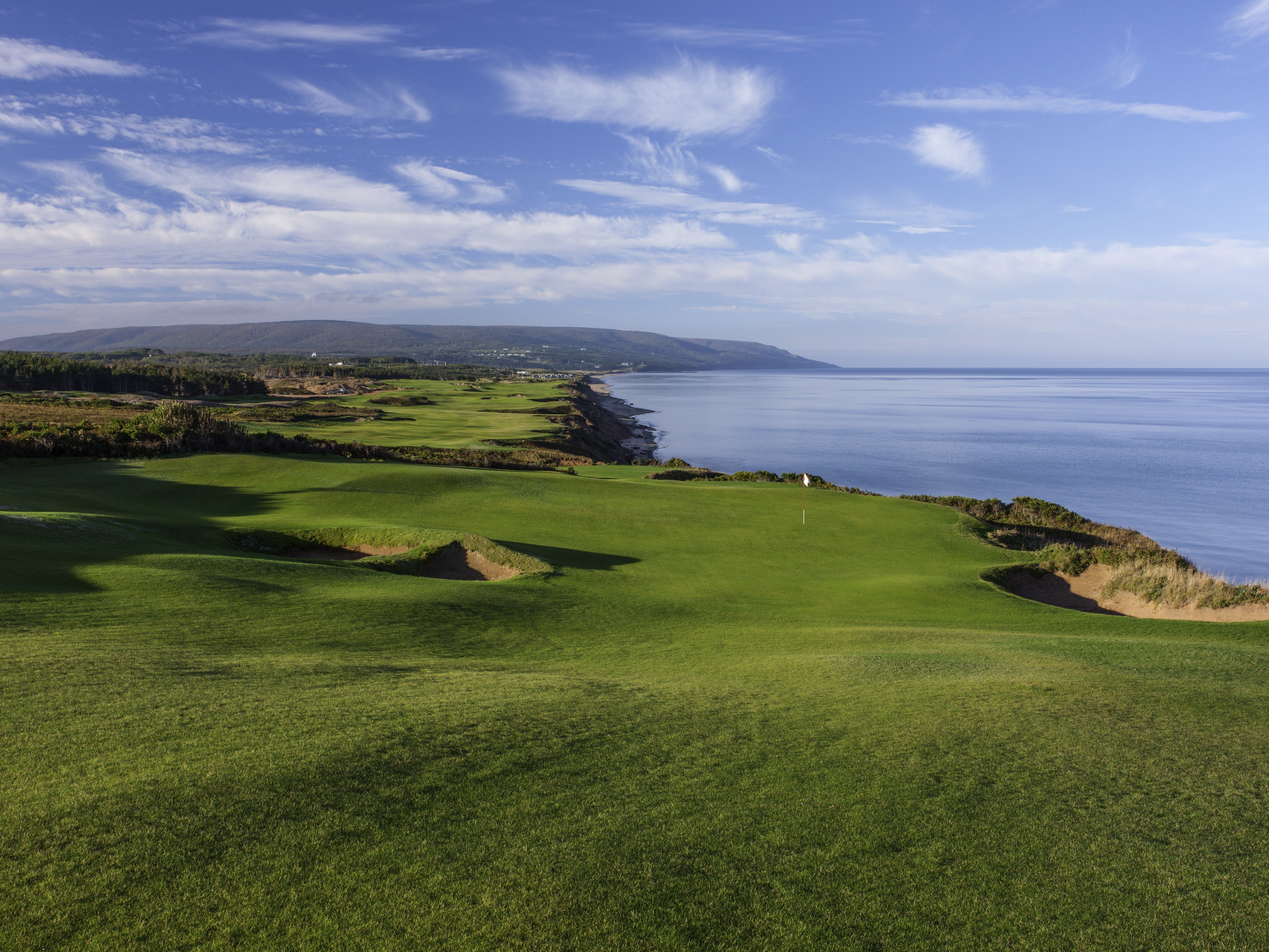 The breathtaking scenery at Cabot Cliffs (17th hole shown) is strikingly similar to the views found a continent away on the Monterey Peninsula.