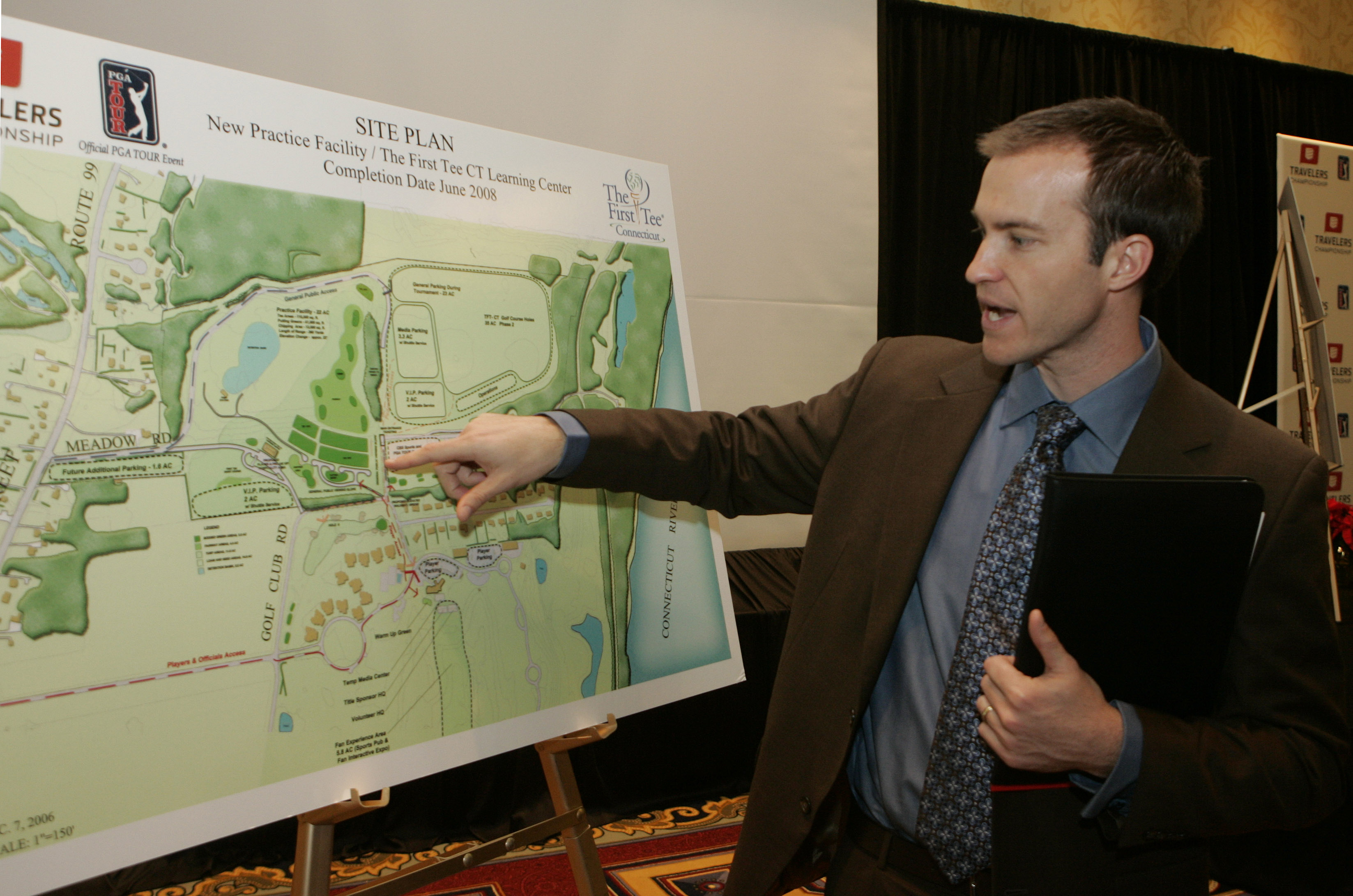 Nathan Grube, Travelers Championship golf tournament director, points out changes made in 2008 to the TPC at River Highlands facility.