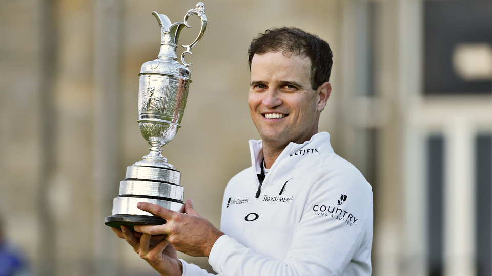 Zach Johnson holds up the Claret Jug after he emerged victorious from the playoff.