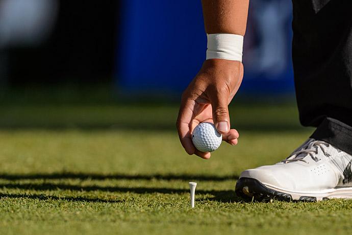 J.J. Spaun tees up his golf ball on Friday.