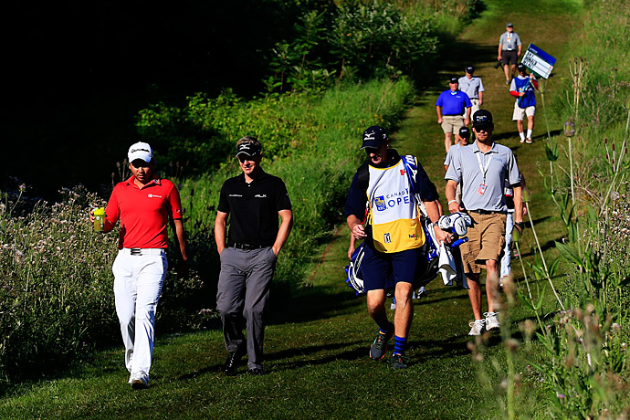 Luke Donald and Jason Day played alongside each other in the second round.