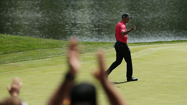 Tiger Woods reacts to a birdie on the ninth green during the final round of the Quicken Loans National at the Robert Trent Jones Golf Club on August 2, 2015 in Gainesville, Virginia.