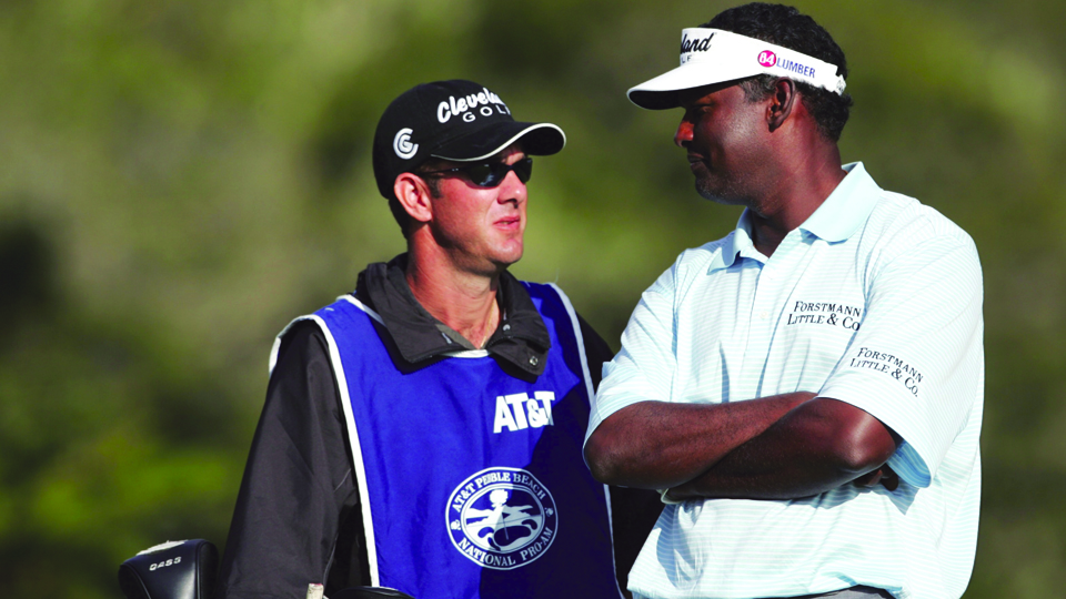 Vijay Singh chats with his caddie Paul Tesori during the third round of the AT&T Pebble Beach National Pro-Am on Feb. 12, 2005.