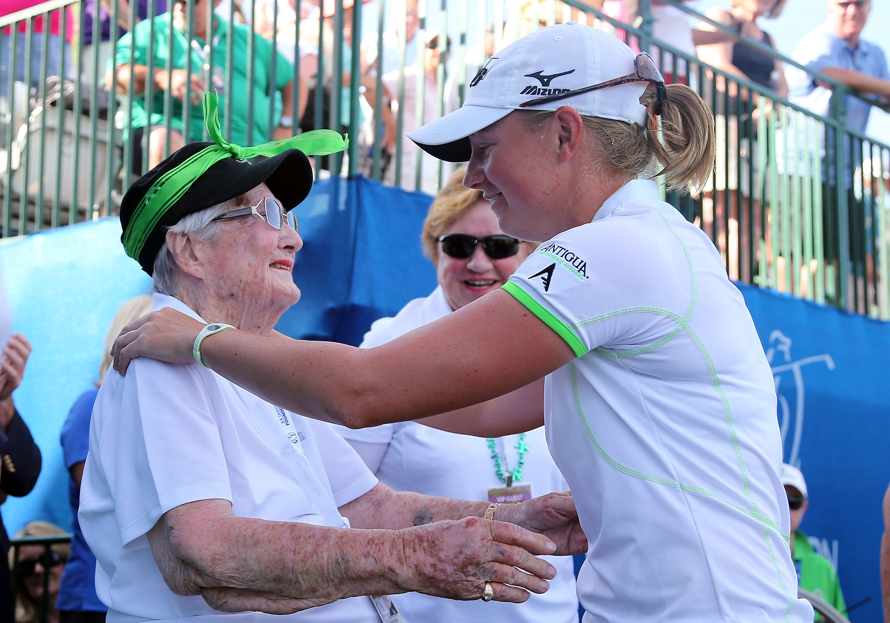 LPGA Tour pro Stacy Lewis greets Louise Suggs during the final round of the 2013 LPGA Founders Cup.