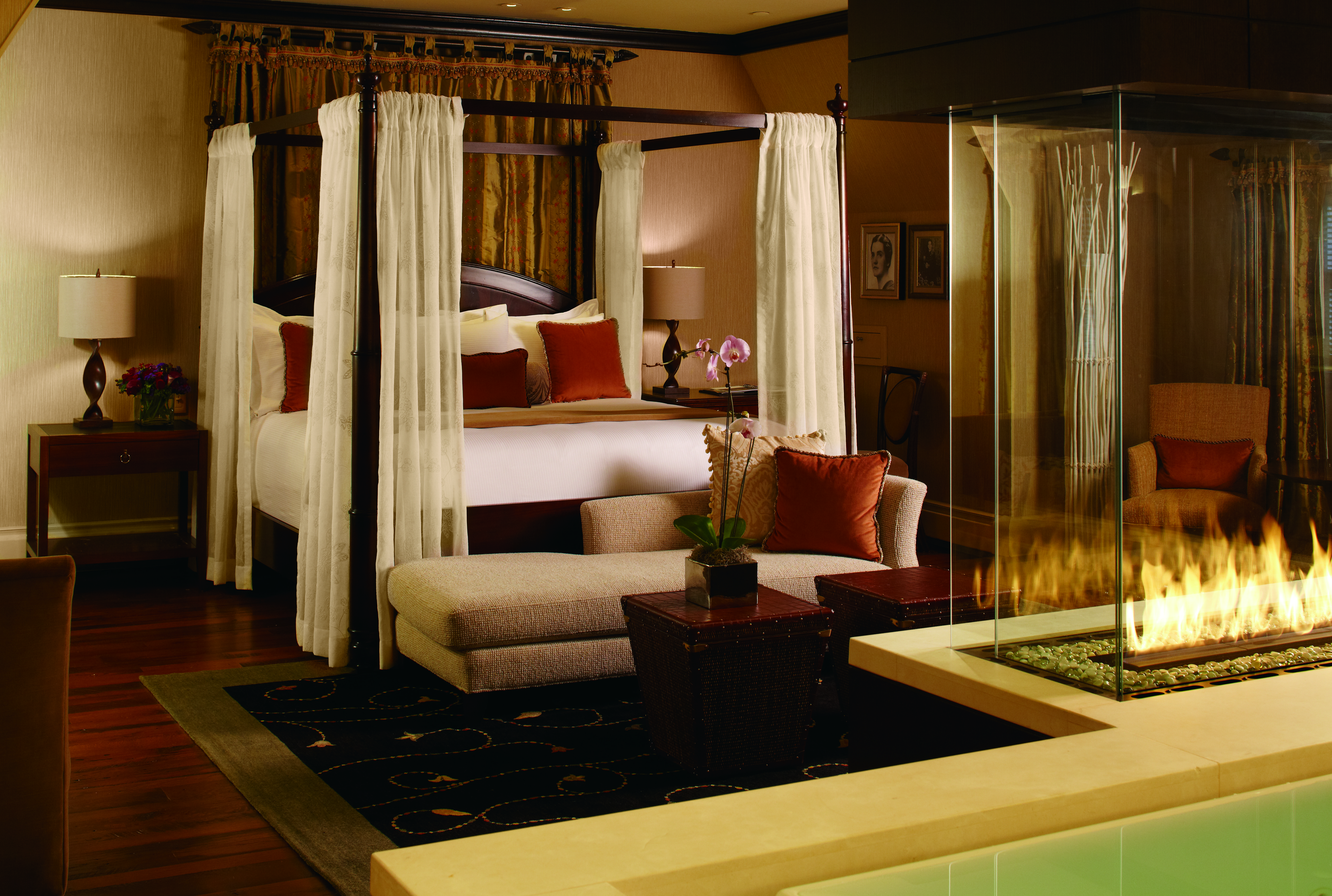 The luxuriously appointed Eau de Vie Suite features a four poster bed.
