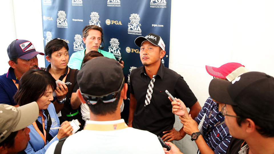 Hiroshi Iwata of Japan speaks with the media after shooting a nine-under par 63 during the second round of the PGA Championship at Whistling Straits on Aug. 14, 2015, in Sheboygan, Wisconsin.