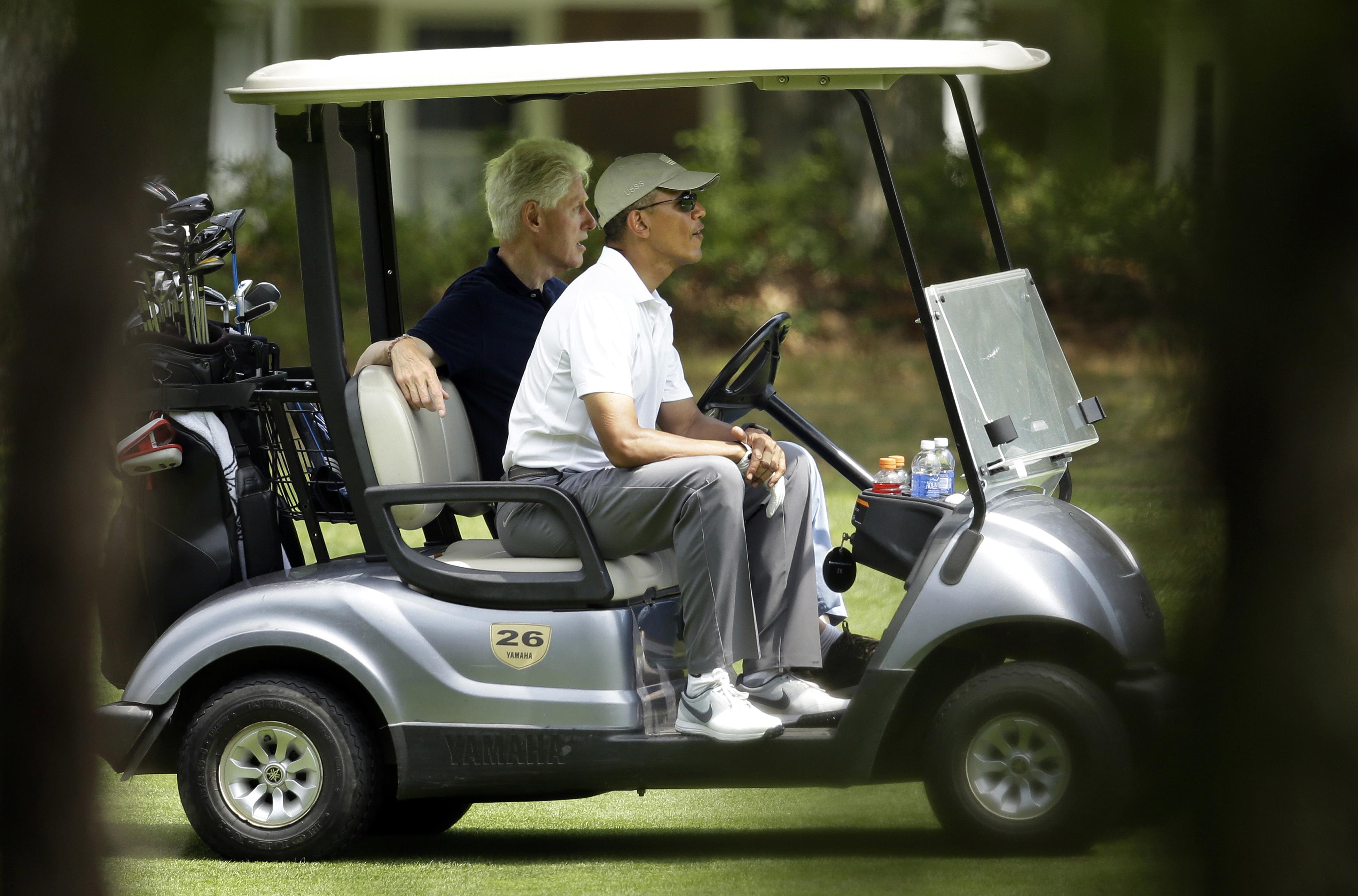 President Barack Obama and former President Bill Clinton enjoy a game of golf on Martha's Vineyard.