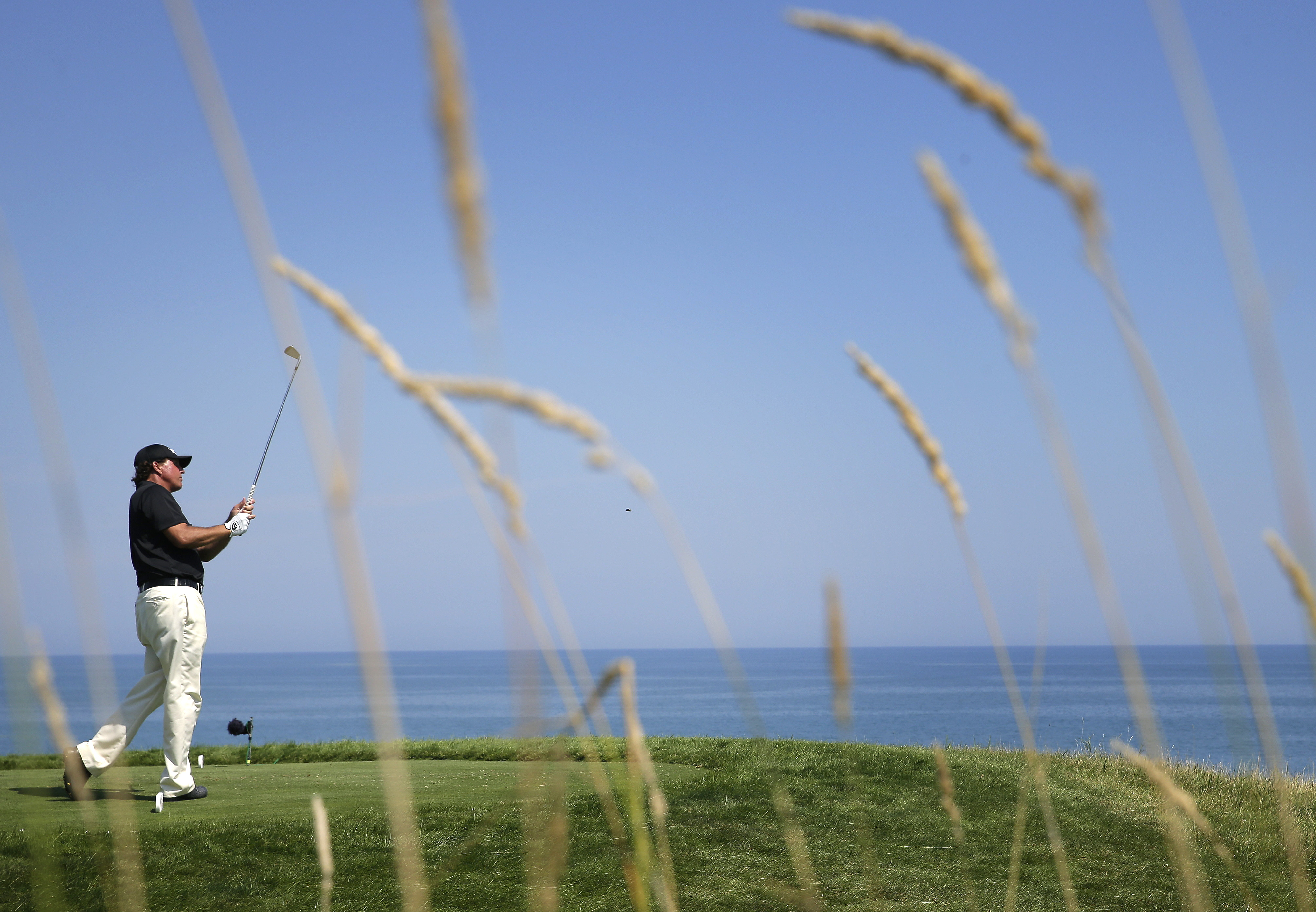 Phil Mickelson hits a tee shot on the 17th hole during the third round of the PGA Championship Saturday, Aug. 15, 2015, at Whistling Straits in Haven, Wisconsin.