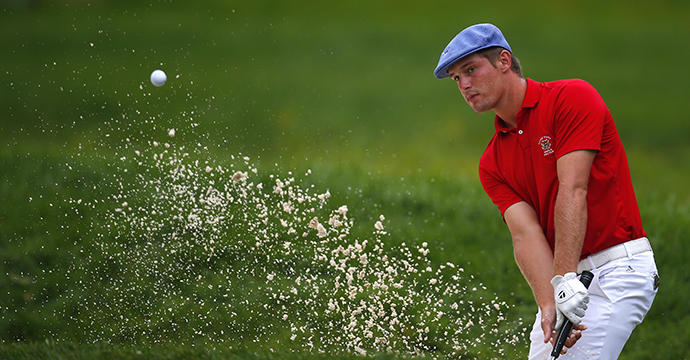 Bryson DeChambeau hits out of the sand trap on the seventh hole during the final match of the U.S. Amateur Championship.