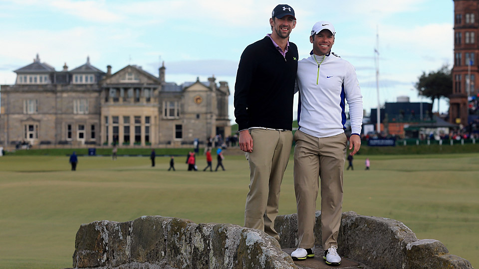 Michael Phelps and Paul Casey pose on the Swilcan Bridge at St. Andrews during the Alfred Dunhill Links Pro-Am.