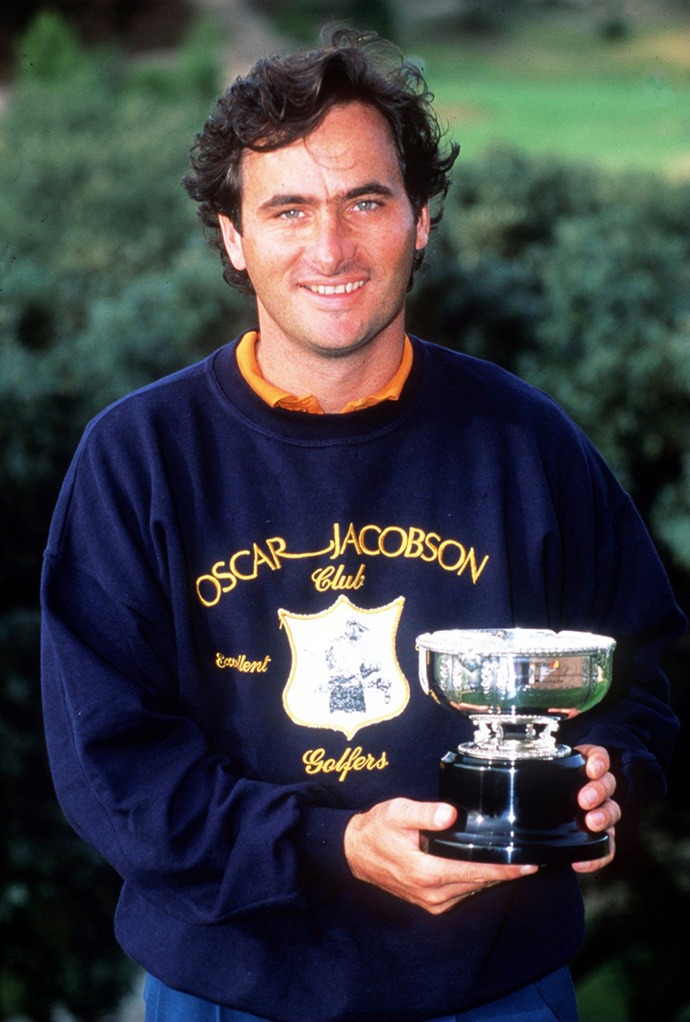 David Feherty holds the trophy after winning the 1990 Madrid Open Golf Championship.