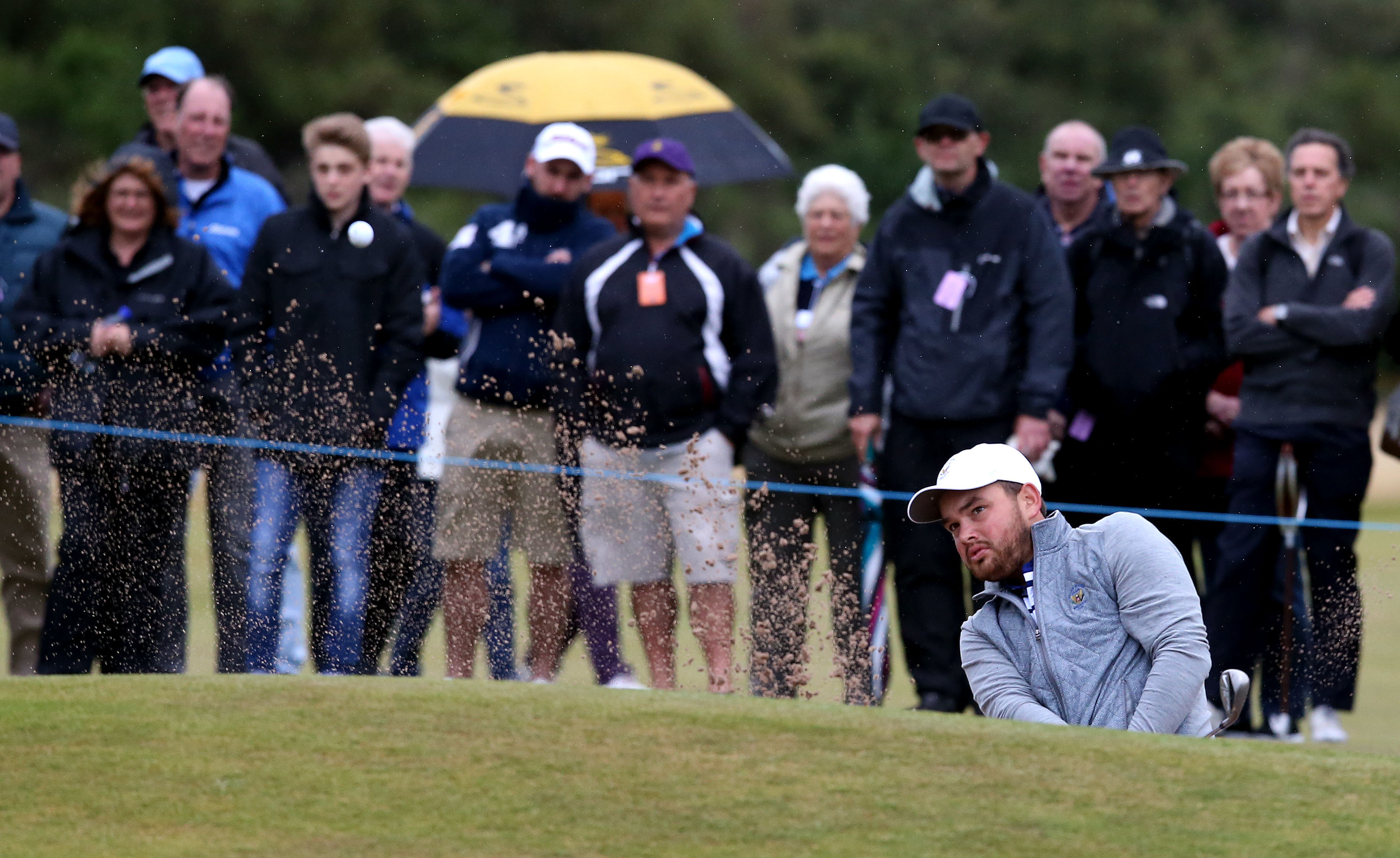 Hunter Stewart of the US plays out of the bunker on the 11th hole during Day 1 of the Walker Cup at Royal Lytham & St Annes Golf Club, Lytham St Annes, England, on Sept. 12, 2015.