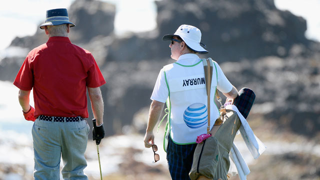 Actor Bill Murray walks with his caddie during the third round of the AT&T Pebble Beach National Pro-Am at the Pebble Beach Golf Links on February 14, 2015 in Pebble Beach, California.