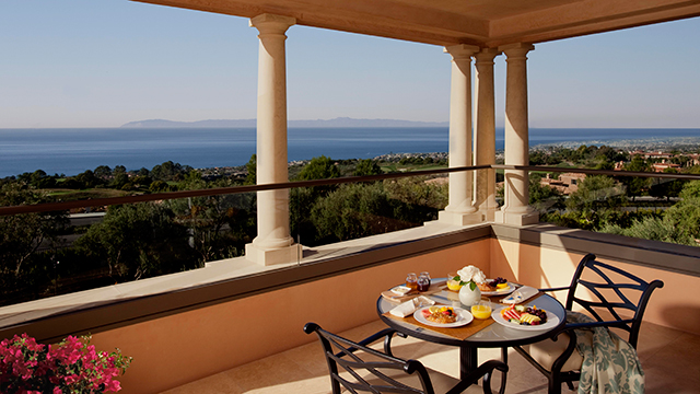 An outdoor patio offers stunning views of the Pacific Ocean.