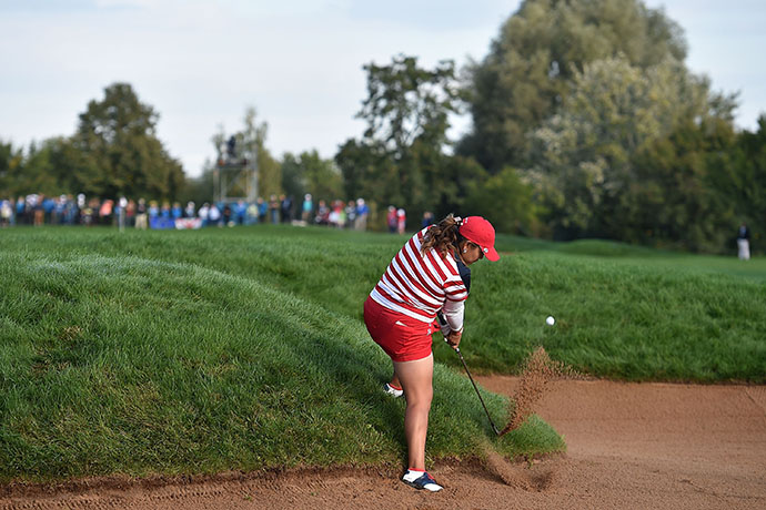 Lizette Salas of the United States Team plays the ball during Friday morning foursomes.