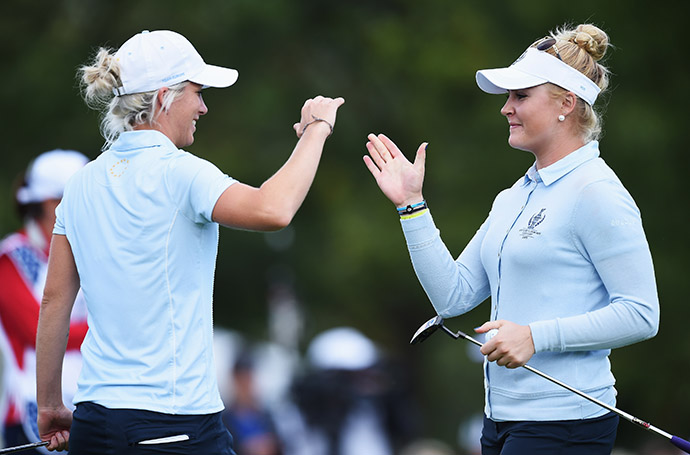 Melissa Reid and Charley Hull of Team Europe celebrate winning their match over Michelle Wie and Brittany Lincicome.