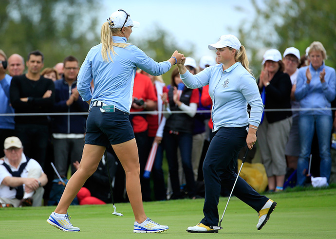 Caroline Hedwall congratulates her partner Anna Nordqvist after holing a birdie putt on the 7th green during the Friday afternoon fourball matches. They topped Pressel and Creamer 4 and 3.