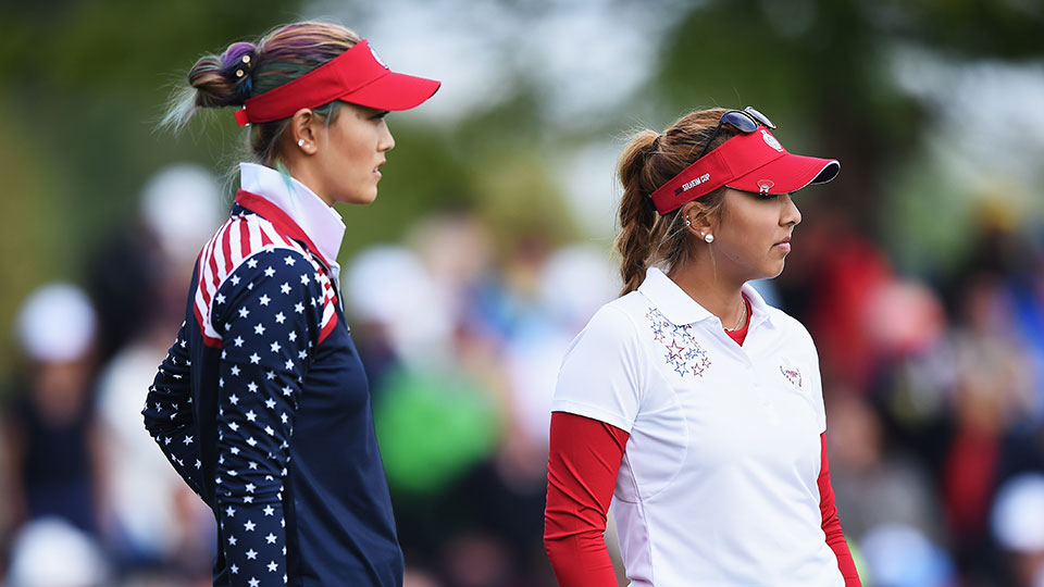 Michelle Wie and Alison Lee of team USA look on during the morning foursomes matches at The Solheim Cup at St Leon-Rot Golf Club on September 19, 2015 in St Leon-Rot, Germany.