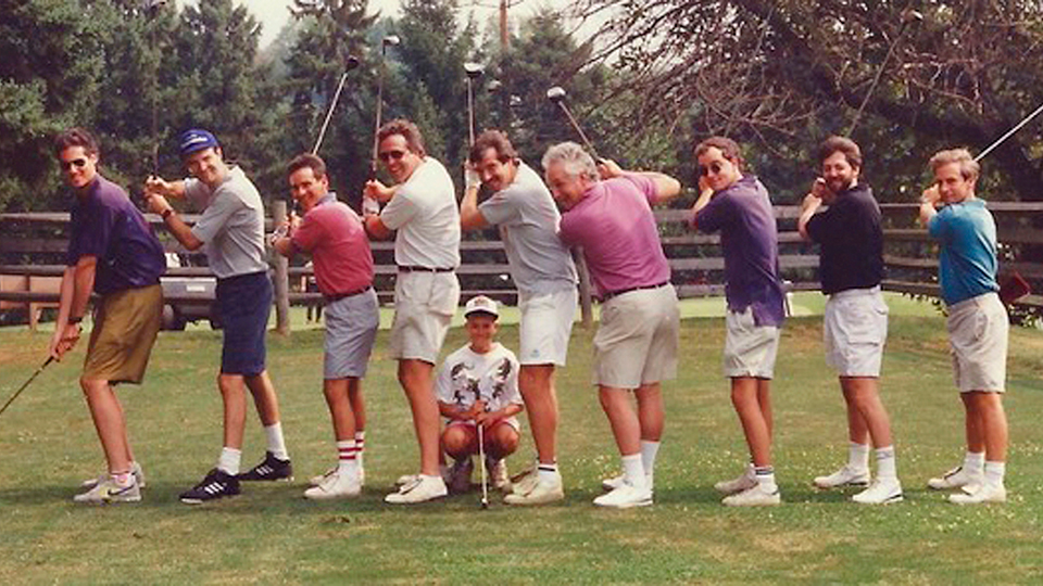A small but enthusiastic group, including the host (center, gray shirt) and his son (crouched) teed off in 1989 at the inaugural C3.