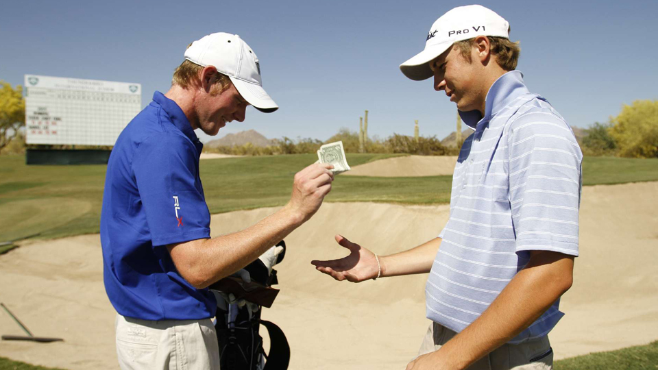 Jordan Spieth (right) once won $1 from Grayson Murray during a practice round for the AJGA Thunderbird International in 2010. I wonder what gambling game they were playing?
