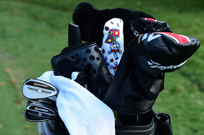 Dustin Johnson chips with TaylorMade R-Series Tour Grind wedges.