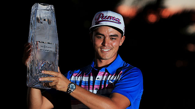 Rickie Fowler poses with the trophy after winning the Players Championship.