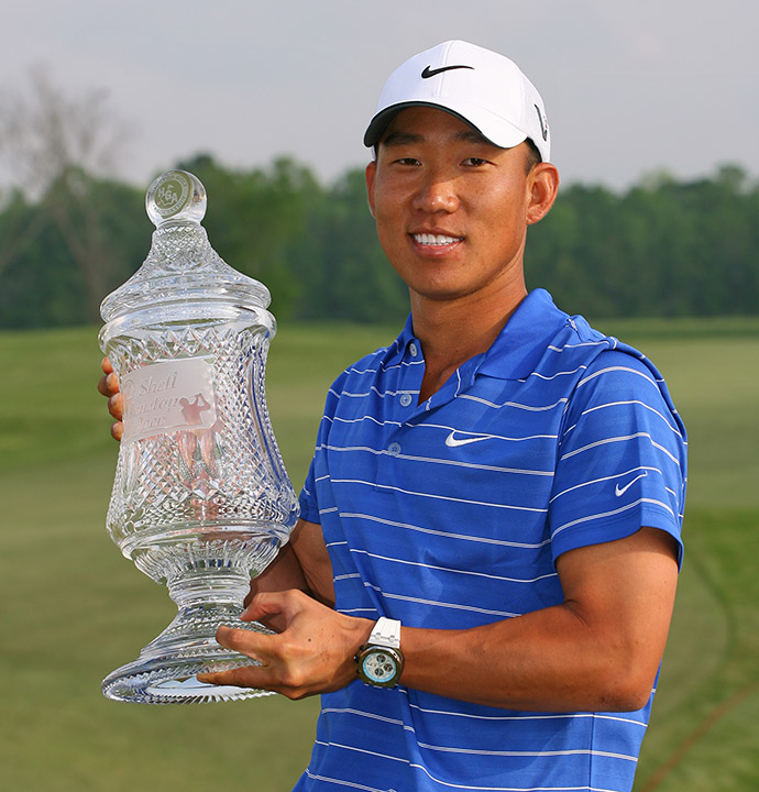 Anthony Kim holds the championship trophy after winning the 2010 Shell Houston Open.