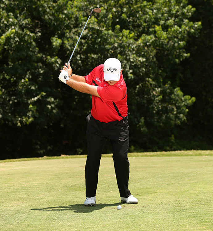 Three-quarter backswing with weigh remaining over the ball.