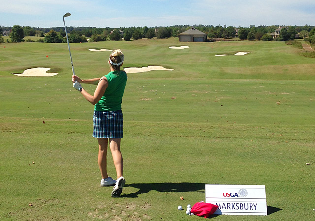 Marksbury warms up on the range at Squire Creek Country Club.