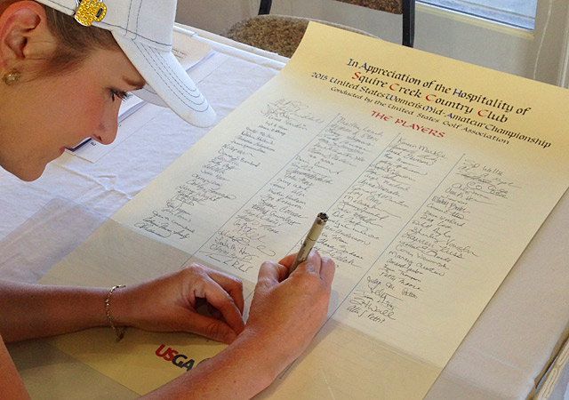 The author signing the official participant record on Thursday.
