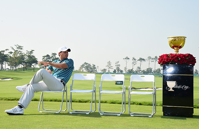 Jason Day of the International Team waits on the practice ground during a photocall prior to the start of The Presidents Cup.