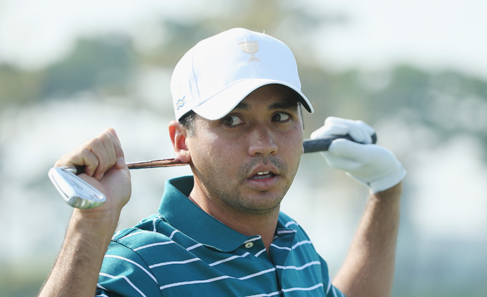 Jason Day of the International Team waits on the practice ground during a practice round.